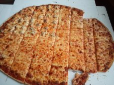 Flat Crust Pizza cut into Squares